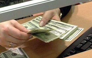 НБУ и реальность: банки используют теневой курс для расчета по карточным оп ...
