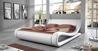 Обустройство спальни: как правильно выбирать двуспальную кровать?